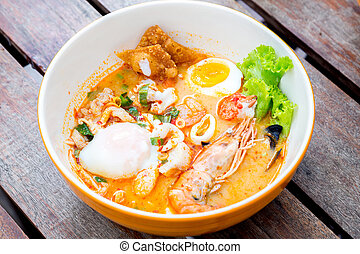 Tomyum seafood noodle - gourmet Tomyum spicy noodle with ...