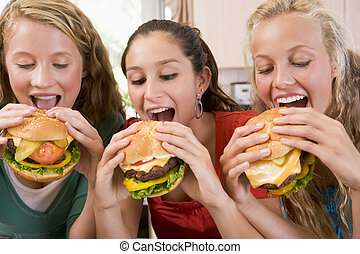 tonårs- flickor, äta, hamburgare