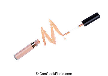 Tonal corrector with a brush on a white background isolated.