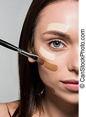 tonal foundation - young attractive woman applying tonal...