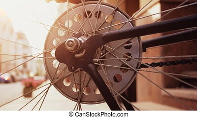 Toned closeup slow motion video of rotating chain, gear and wheel on vintage sport bicycle