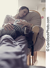 Toned image of a woman resting on a chair indoors during the day