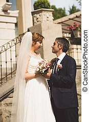Toned portrait of bride and groom looking at each other