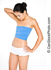 Toned stomach - Young attractive asian women in small blue...