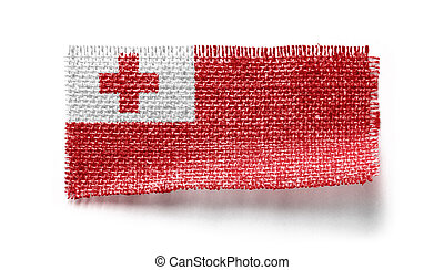 Tonga flag on a piece of cloth on a white background