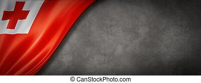 Tonga flag on concrete wall banner