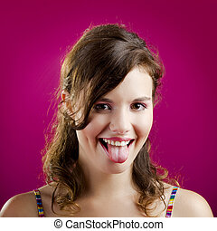Tongue out - Portrait of a beautiful young woman with her...