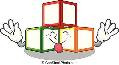 Tongue out toy blocks on cube boxes mascot vector...