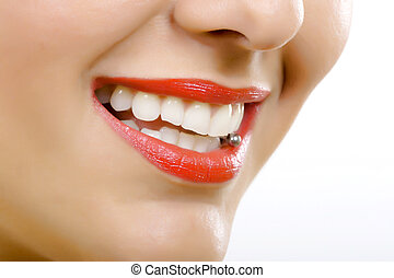 Tongue piercing - closeup picture og a woman\'s tongue...