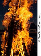 Tongues of flame at sunset at pagan holiday