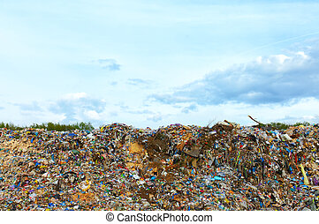 tons of plastic waste on sky background