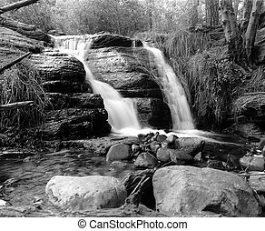 Spring water fall Tonto creek in White mountains Arizona