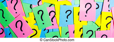 Too Many Questions. Pile of colorful paper notes with question marks. Closeup