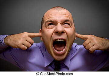 Too much noise - Adult businessman screaming in pain over...