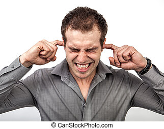 Too much noise concept - man covering ears with fingers -...