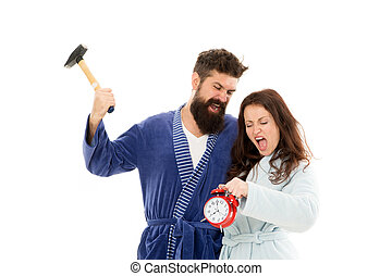 Too much noise. Couple oversleep awakening hold alarm clock. Lack of sleep. Too early awakening. Oversleep, not getting enough sleep concept. Frustrated tired couple oversleep. angry man and woman