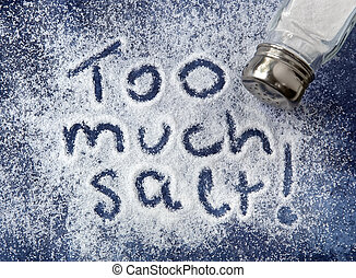 """Too much salt!"" written in salt, with shaker. Warning related to diabetes, high blood pressure, etc."