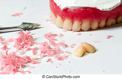 tool make a wax dentures model. table of dental technician workplace.