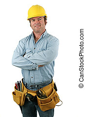 A construction worker with a tool belt smiling. Isolated.