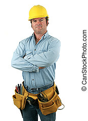 A construction worker with his arms crossed, looking serious. Isolated.