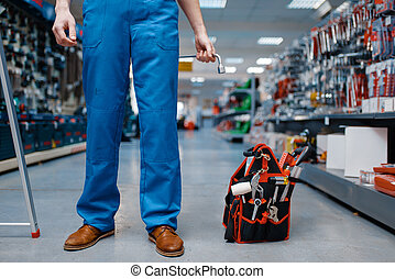 Toolbox in tool store, worker on background