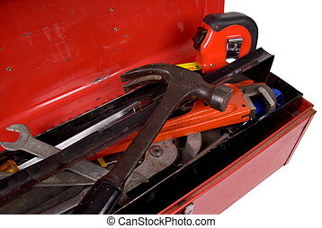 Toolbox - Old used and rusty tools in a red toolbox over a...