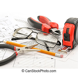 Tools and glasses on the drawing