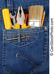 tools and instruments in blue jeans