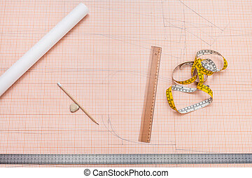 tools for clothing pattern drawing on graph paper