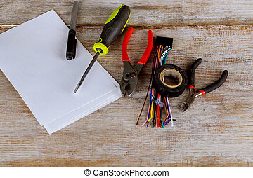 Tools for electrical installation isolated on metal surface