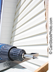 Tools for mounting the siding, screwdriver and level