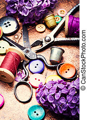 Tools for needlework and lilac branch