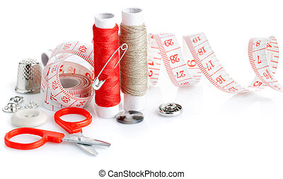 tools for needlework thread scissors and tape measure isolated on white background