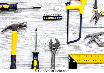 Tools for repairing on grey desk background top view