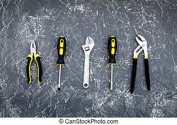 Tools for repairing top view on stone background.