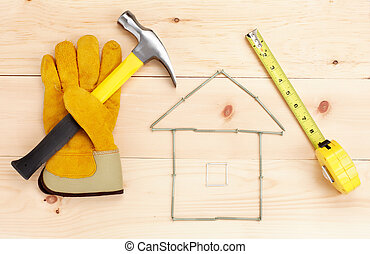 Tools. Hammer and ruler - Hammer and ruler over wood plank....
