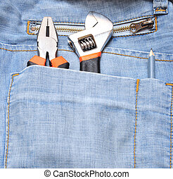 tools in a blue jeans pocket