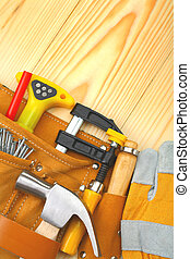 tools in belt on wooden boards