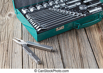 Tools in box on wooden background