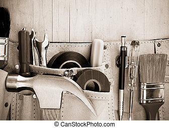 tools in construction belt on wooden background texture