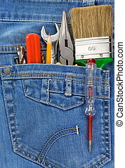 tools in old blue jeans pocket