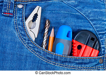 Tools in pocket jeans.