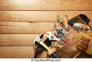 tools in tool belt on wood planks with copy space