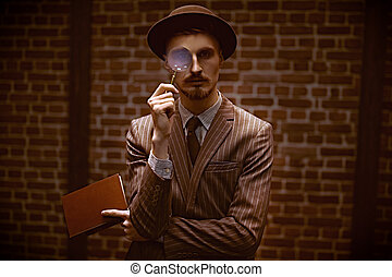tools of the detective - Detective man looking intently ...