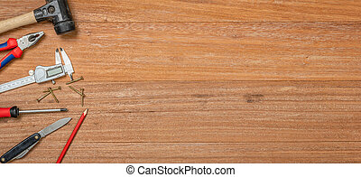 Tools on a wooden background with copy space