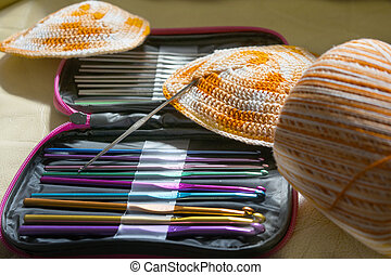 preparing a bikini with tools for crochet and colored skein