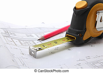 tools with construction blueprint