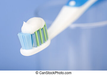 tooth brush. Over blue background