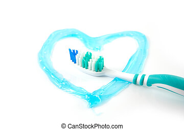 Tooth brush with a heart in tooth paste, so say that you...