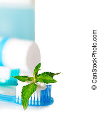 Tooth brushes with mint, tooth paste and dental floss isolated on white. Stomatology equipment and dental care
